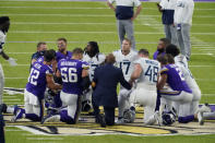 FILE - In this Sept. 21, 2020, file photo, Tennessee Titans and the Minnesota Vikings players meet at midfield following an NFL football game in Minneapolis. Tennessee will not be returning to the team's facility Wednesday, Oct. 7, 2020, after two more players tested positive in the NFL's first COVID-19 outbreak, a person familiar with the situation told The Associated Press. The Titans had no positive tests Monday or Tuesday for the first time after six consecutive days of positive results. A third straight day was necessary for the team to be allowed back in its headquarters.(AP Photo/Jim Mone, File)