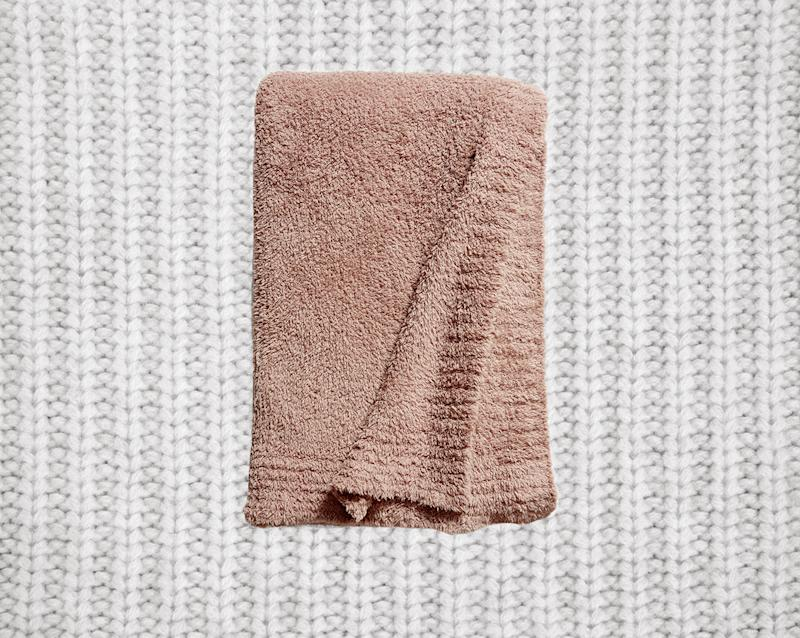 Everyone in your family will fight over who gets to snuggle under this blanket. (Photo: Nordstrom)
