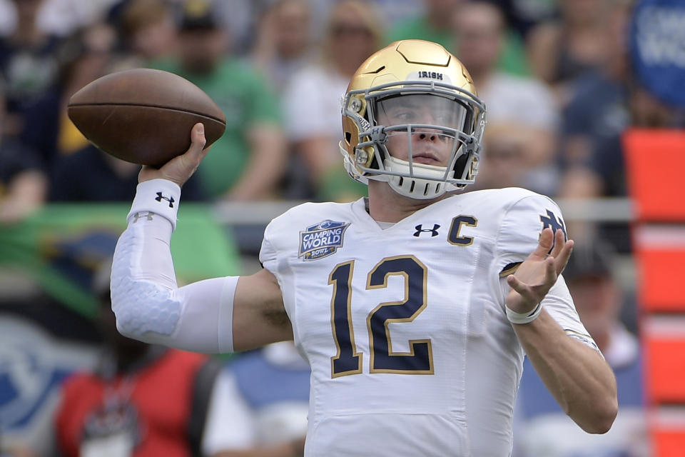 Notre Dame quarterback Ian Book (12) throws a pass during the first half of the Camping World Bowl NCAA college football game against Iowa State Saturday, Dec. 28, 2019, in Orlando, Fla. (AP Photo/Phelan M. Ebenhack)