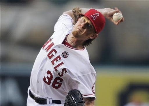 Los Angeles Angels starting pitcher Jered Weaver throws against the Oakland Athletics during the first inning of a baseball game on Friday, July 19, 2013, in Anaheim, Calif. (AP Photo/Jae C. Hong)