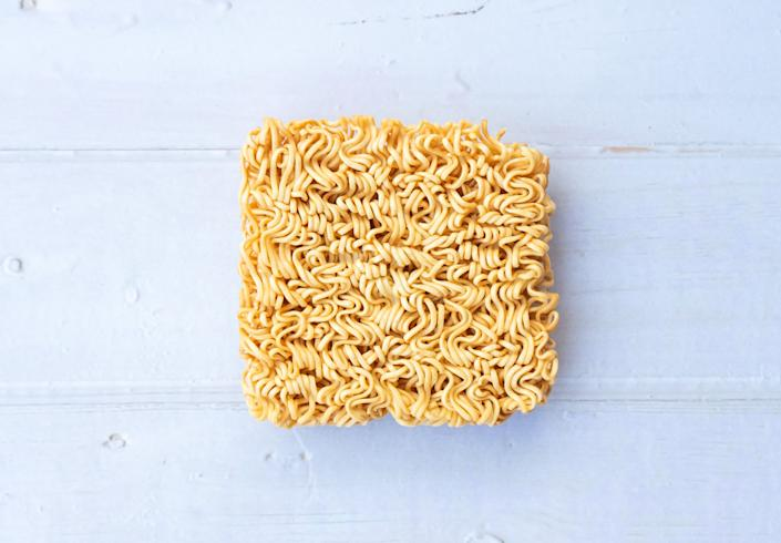 """A package of ramen usually lists one serving as being just half of the """"brick"""" of noodles. (Photo: Patcharanan Worrapatchareeroj via Getty Images)"""