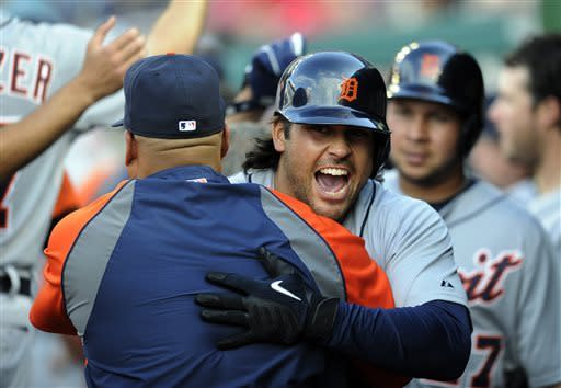 Detroit Tigers' Matt Tuiasosopo reacts in the dugout after hitting a three-run home run against the Washington Nationals during the sixth inning of a baseball game, Thursday, May 9, 2013, in Washington. (AP Photo/Nick Wass)