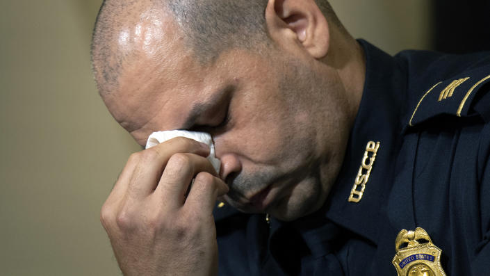 U.S. Capitol Police Sgt. Aquilino Gonell wipes his eyes as he watches a video before the House select committee hearing on the Jan. 6 attack on Capitol Hill in Washington, Tuesday, July 27, 2021. (Brendan Smialowski/Pool via AP)
