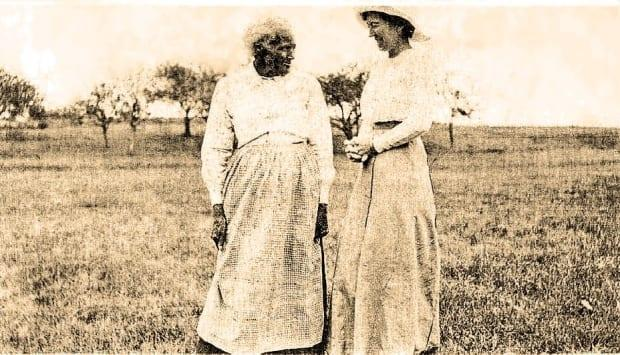 Charlotte Watson is pictured, left, in a photo taken around 1900, with Margaret Jane Menzie on Menzie Road in Kings County. (Submitted by Barb Pearce - image credit)