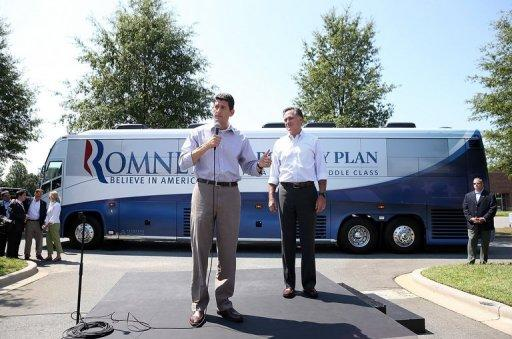 Republican presidential candidate Mitt Romney (R) looks on as his running mate Rep. Paul Ryan speaks a crowd