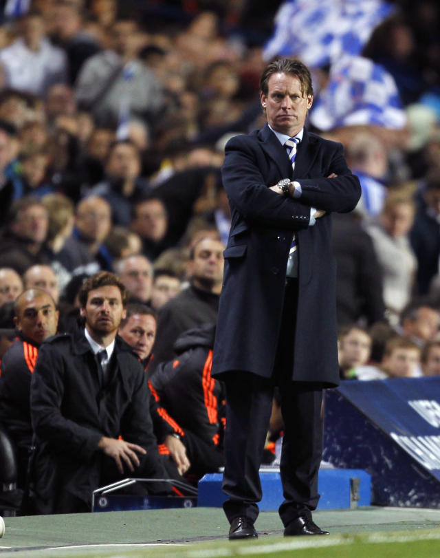 Manager of KRC Genk Mario Been (R) gestures as Chelsea's Portuguese Manager Andre Villas-Boas (L) watches on during their UEFA Champions League Group E football match between Chelsea and KRC Genk at Stamford Bridge in London on October 19, 2011. AFP PHOTO / IAN KINGTON (Photo credit should read IAN KINGTON/AFP/Getty Images)