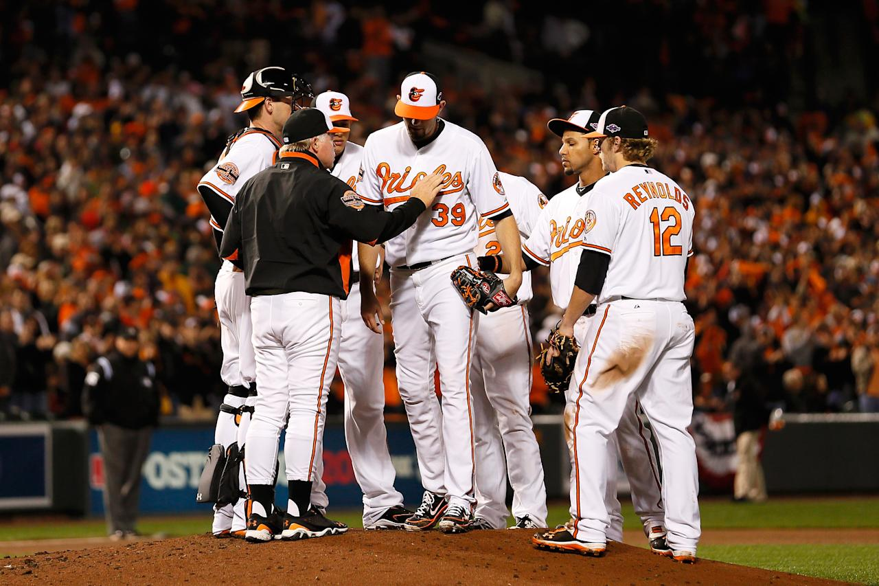 BALTIMORE, MD - OCTOBER 07:  Manager Buck Showalter of the Baltimore Orioles takes starting pitcher Jason Hammel #39 in the top of the sixth inning against the New York Yankees during Game One of the American League Division Series at Oriole Park at Camden Yards on October 7, 2012 in Baltimore, Maryland.  (Photo by Rob Carr/Getty Images)