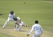 South Africa's Temba Bavuma plays a shot, on day three of the first cricket test match between South Africa and Sri Lanka at Super Sport Park Stadium in Pretoria, South Africa, Monday, Dec. 28 2020. (AP Photo/Catherine Kotze)