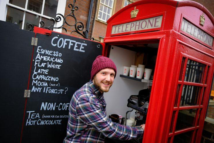 A coffee-loving businessman has opened what could be Britain's smallest cafe - inside a disused red phone box.