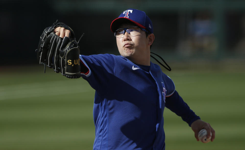 SURPRISE, ARIZONA - MARCH 07: Pitcher Hyeon-jong Yang #68 of the Texas Rangers throws against the Los Angeles Dodgers during the eighth inning of the MLB spring training baseball game at Surprise Stadium on March 07, 2021 in Surprise, Arizona. (Photo by Ralph Freso/Getty Images)