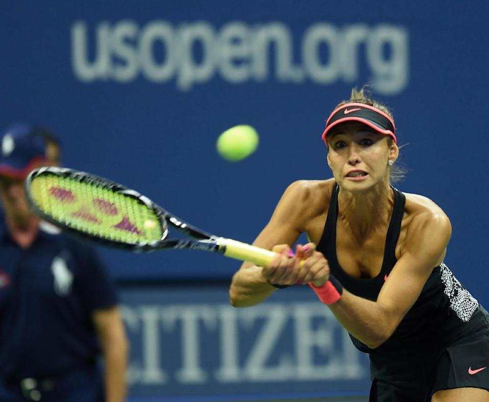 Vitalia Diatchenko hits a return to Serena Williams during their US Open match in New York on August 31, 2015 (AFP Photo/Don Emmert)