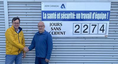 AEM Canada, Managing Director, Mr Julian Ford congratulating Production Director, Mr Michel Arseneault on achieving, first HPA commercial production at the Cap Chat site, in Quebec, Canada. (CNW Group/AEM Canada Inc)