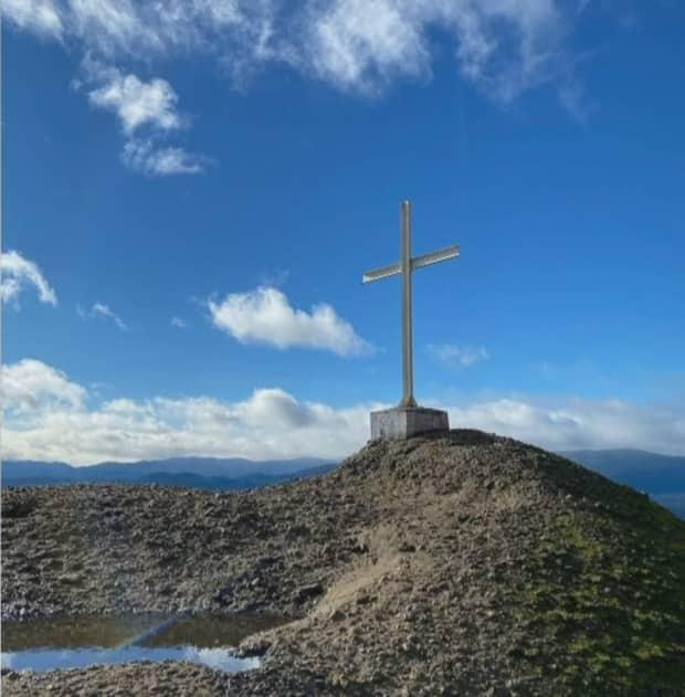 This metal cross has been a fixture at the top of Mount Tzouhalem outside of Duncan, B.C., for decades. It was cut down and removed at some point during the week of July 12.  (CHEK News - image credit)