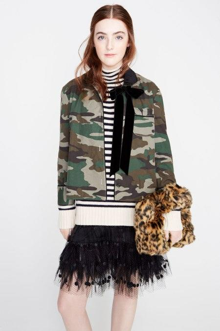 Liv Freundlich gets her modeling debut sporting a cameo jacket and fringed skirt for J. Crew (Photo by Getty Images).
