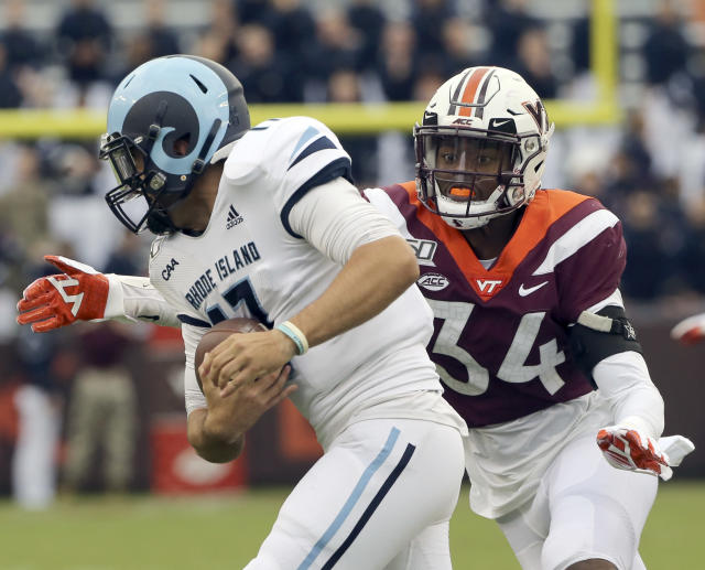 Rhode Island quarterback Vito Priore (17) is sacked by Virginia Tech defender Alan Tisdale (34) in the first half of an NCAA college football game in Blacksburg Va., Saturday, Oct. 12 2019. (Matt Gentry/The Roanoke Times via AP)
