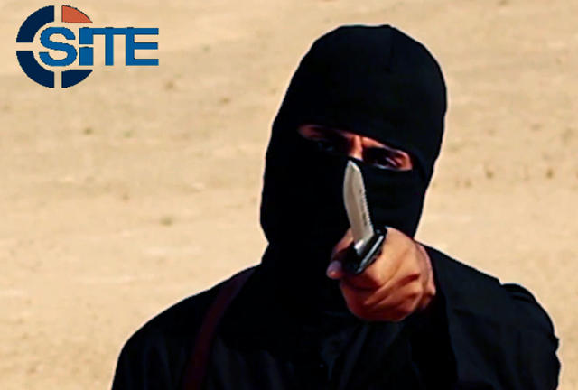 "A masked, black-clad militant, identified as Mohammed Emwazi (""Jihadi John""), is pictured in 2014. Members of his terrorist cell, Alexanda Kotey and El Shafee Elsheikh, have reportedly been captured."