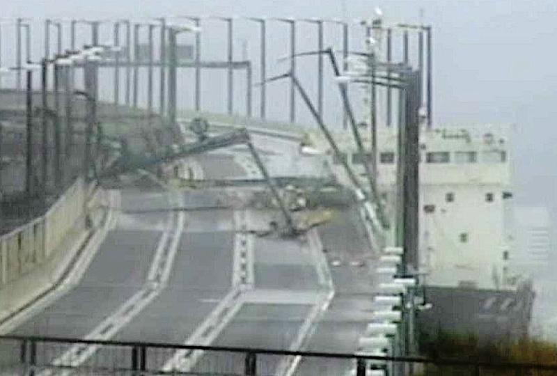 The tanker colliding with a bridge during a typhoon became an iconic image (AFP Photo/JIJI PRESS)