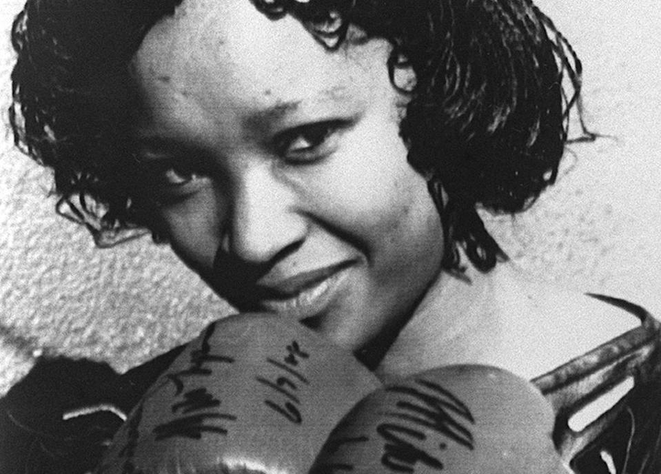 Zindzi Mandela wearing boxing gloves given to her father by the World Heavyweight Boxing Champion Mike Tyson as a present for his 70th birthday in 16 July 1988 in Soweto