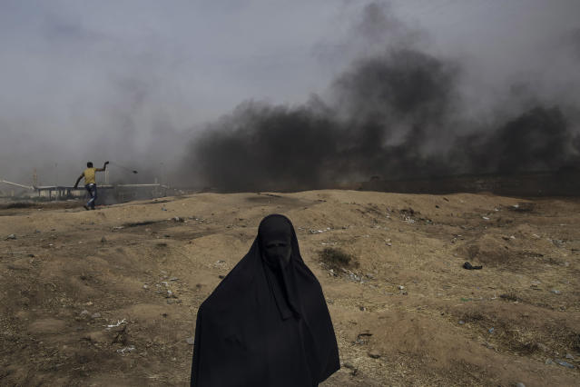 "<p>A Palestinian woman is seen at the Eastern Gaza City's border with Israel during the ""Great March of Return"" protests on April 20, 2018. (Photo: Fabio Bucciarelli for Yahoo News) </p>"