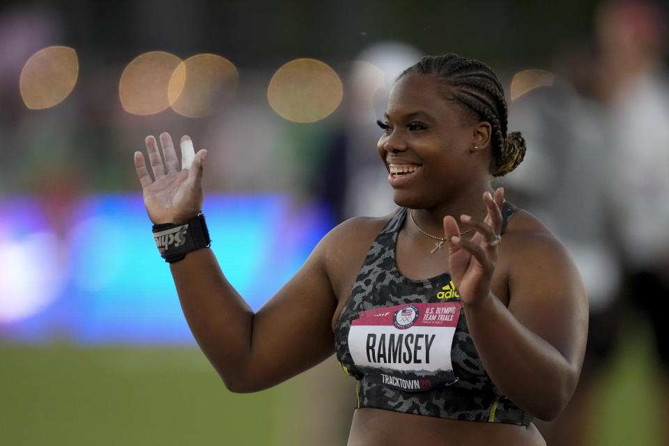 Jessica Ramsey celebrates during the finals for the women's shot put at the U.S. Olympic Track and Field Trials Thursday, June 24, 2021, in Eugene, Ore. (AP Photo/Charlie Riedel)