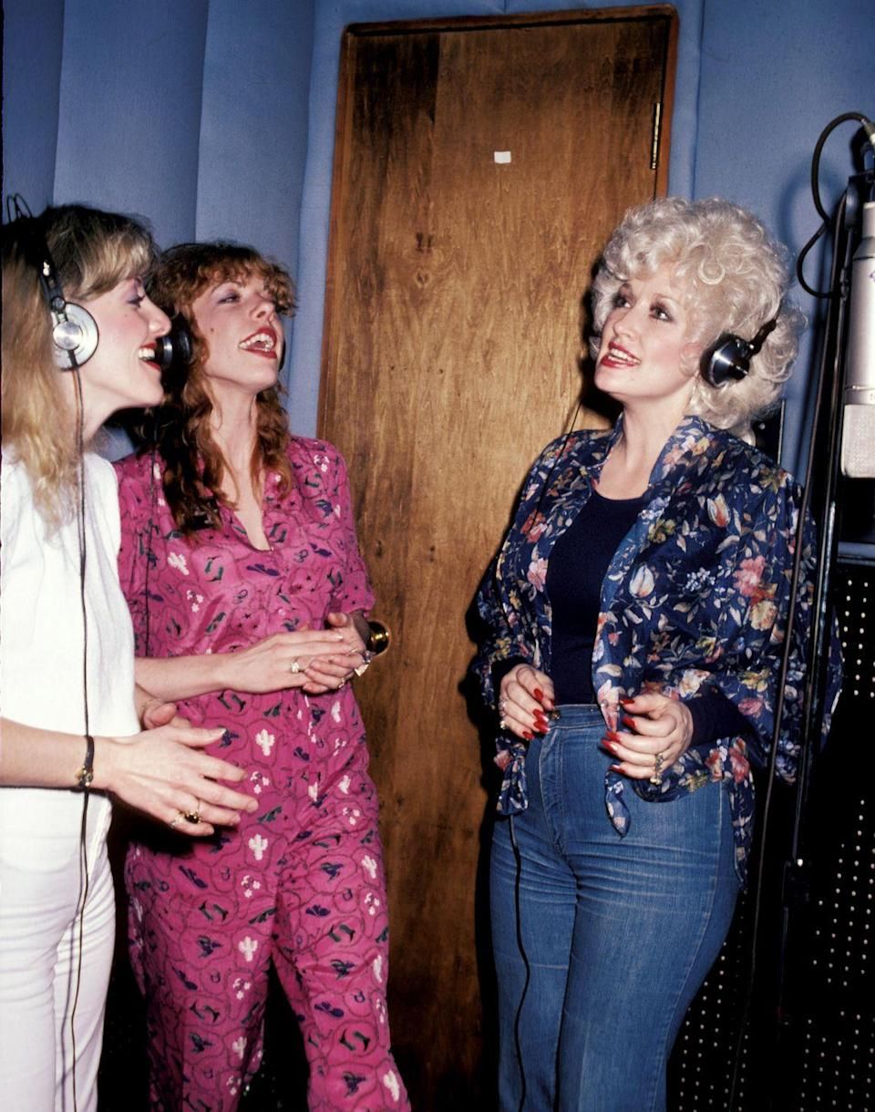 <p>Stella Parton and Frieda Parton are both singers like their sister Dolly. Here the trio is recording a song.</p>