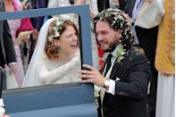 """<p><a href=""""https://www.womenshealthmag.com/relationships/a27632290/kit-harington-rose-leslie-relationship-timeline/"""" rel=""""nofollow noopener"""" target=""""_blank"""" data-ylk=""""slk:Rose Leslie and Kit Harington"""" class=""""link rapid-noclick-resp"""">Rose Leslie and Kit Harington</a> met while filming Game of Thrones, in which they played on-screen couple Ygritte and Jon Snow, respectively. </p><p>Kit told <a href=""""https://www.vogue.it/en/fashion/cover-fashion-stories/2016/05/11/kit-harington/"""" rel=""""nofollow noopener"""" target=""""_blank"""" data-ylk=""""slk:Vogue Italia"""" class=""""link rapid-noclick-resp"""">Vogue Italia</a>: '[Iceland] is beautiful, because the Northern Lights are magical, and because it was there that I fell in love' he said. 'If you're already attracted to someone, and then they play your love interest in the show, it becomes very easy to fall in love.'</p><p>After briefly breaking up in 2013, the couple got married in a beautiful <a href=""""https://people.com/tv/kit-harington-rose-leslie-married-wedding-photos/"""" rel=""""nofollow noopener"""" target=""""_blank"""" data-ylk=""""slk:2018 Scotland ceremony"""" class=""""link rapid-noclick-resp"""">2018 Scotland ceremony</a>.</p>"""