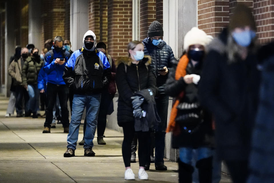 FILE - In this Feb. 3, 2021, file photo, people wait in line at a COVID-19 vaccination site at the Pennsylvania Convention Center in Philadelphia. The clinic opened to help provide second doses of COVID-19 vaccinations. (AP Photo/Matt Rourke, File)