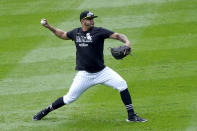 Chicago White Sox's Carlos Rodon throws a short pitching session after Game 4 of an ALDS baseball game was postponed due to a forecast of inclement weather Monday, Oct. 11, 2021, in Chicago. The makeup game is scheduled for Tuesday afternoon at Guaranteed Rate Field. (AP Photo/Charles Rex Arbogast)