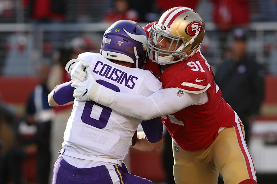 Kirk Cousins of the Minnesota Vikings is sacked by Arik Armstead of the San Francisco 49ers. (Photo by Sean M. Haffey/Getty Images)