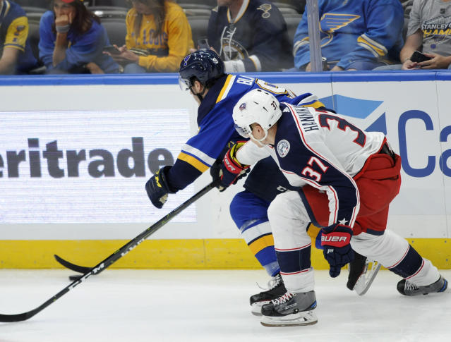 Columbus Blue Jackets' Markus Hannikainen (37), of Finland, reaches for the puck with St. Louis Blues' Sammy Blais (9) during the second period of an NHL preseason hockey game, Sunday, Sept. 22, 2019, in St. Louis. (AP Photo/Bill Boyce)