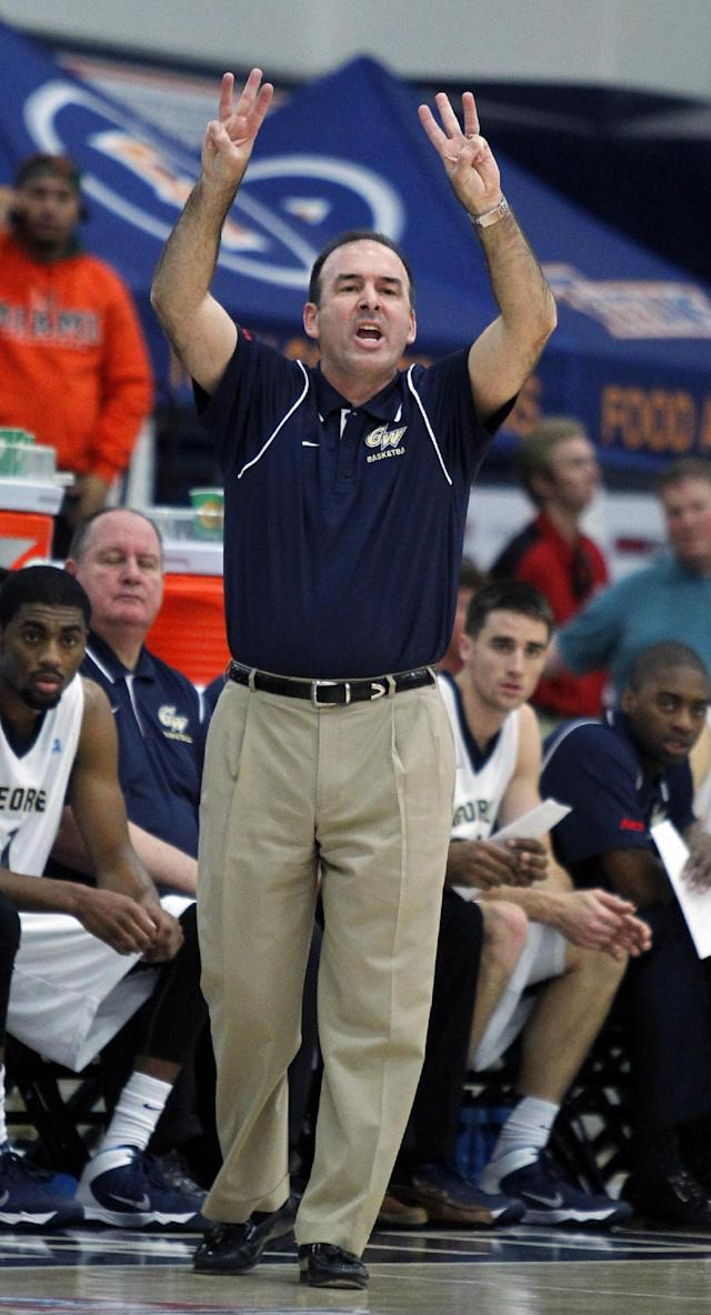 George Washington head coach Mike Lonergan calls in a play against Miami in the first half at the Wooden Legacy NCAA college basketball tournament, Thursday, Nov. 28, 2013, in Fullerton, Calif. (AP Photo/Alex Gallardo)