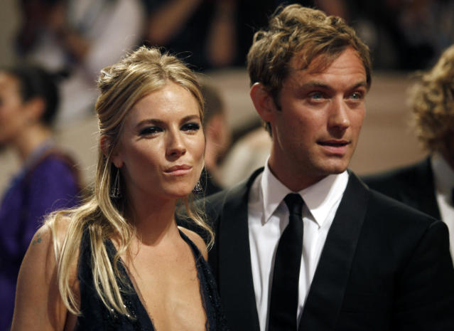 Sienna Miller and Jude Law arrive at the Metropolitan Museum of Art Costume Institute Benefit in New York.