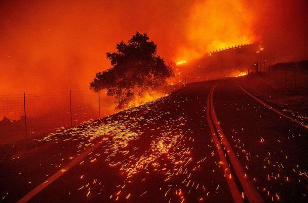 PHOTO: Embers blow across a road as wind rips through the area during the Kincade Fire near Geyserville, California on October 24, 2019. (Josh Edelson/AFP via Getty Images)