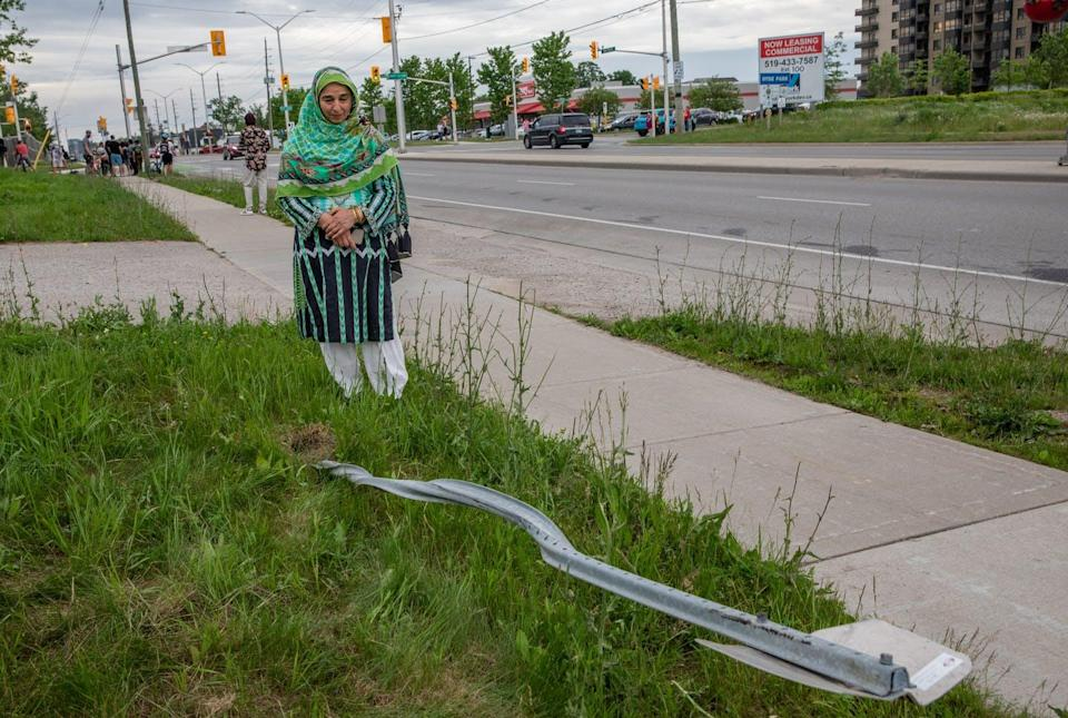 """<span class=""""caption"""">Mourners visit the site where a Muslim family of five was deliberately run over by a driver on June 6, 2021.</span> <span class=""""attribution""""><span class=""""source"""">(THE CANADIAN PRESS/Brett Gundlock)</span></span>"""