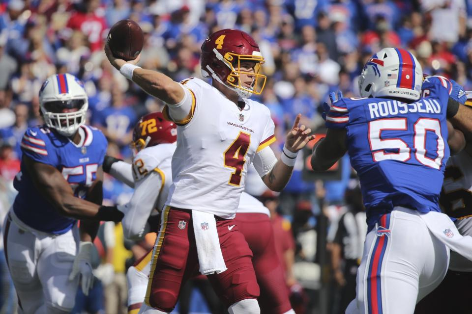 Washington Football Team quarterback Taylor Heinicke (4) throws a pass during the first half of an NFL football game against the Buffalo Bills, Sunday, Sept. 26, 2021, in Orchard Park, N.Y. (AP Photo/Jeffrey T. Barnes)