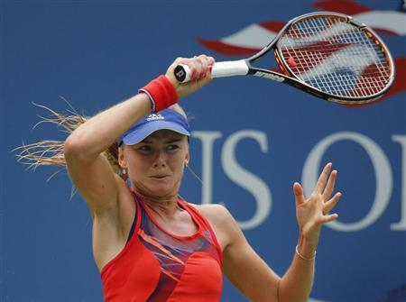 Hantuchova of Slovakia returns to Riske of the U.S. at the U.S. Open tennis championships in New York