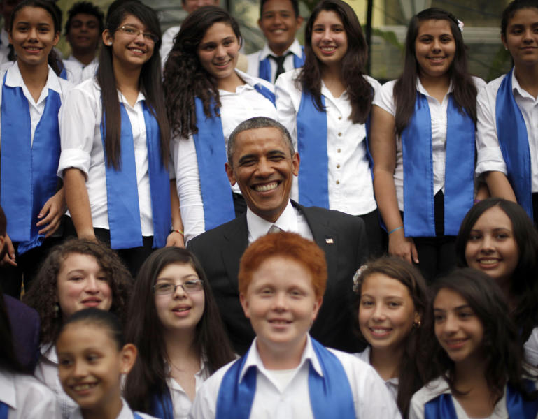 President Barack Obama smiles as he poses for a group photo at a cultural event with youth performers in San Jose, Costa Rica, Friday, May 3, 2013. (AP Photo/Pablo Martinez Monsivais)