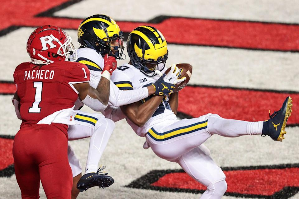 Michigan Wolverines defensive back Daxton Hill (30) intercepts a pass intended for Rutgers Scarlet Knights running back Isaih Pacheco during the third overtime at SHI Stadium, Nov. 22. 2020.