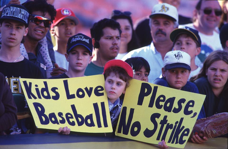 OAKLAND, CA - AUGUST 11:  (FILE PHOTO) Fans hold up signs in protest of the baseball strike on August 11, 1994 during a game between the Seattle Mariners and the Oakland Athletics at the Oakland Coliseum in Oakland, California. A senior member of the union's executive board said baseball players set a strike date for August 30, 2002.  The strike puts the sport on course for its ninth work stoppage since 1972.  (Photo by Otto Greule/Getty Images)