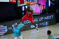 New Orleans Pelicans' Zion Williamson (1) comes down after a dunk over Memphis Grizzlies' Anthony Tolliver (44) during the first half of an NBA basketball game Monday, Aug. 3, 2020 in Lake Buena Vista, Fla. (AP Photo/Ashley Landis, Pool)