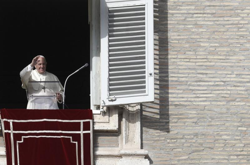 Pope Francis delivers his blessing during his Angelus prayer from his studio window overlooking St. Peter's Square, at the Vatican, Sunday, Nov. 10, 2019. (AP Photo/Gregorio Borgia)