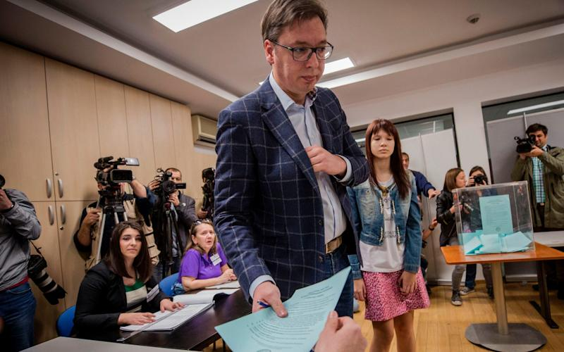 Aleksandar Vucic arrivesto vote at a polling station in Belgrade - Credit:  OLIVER BUNIC/AFP/Getty Images