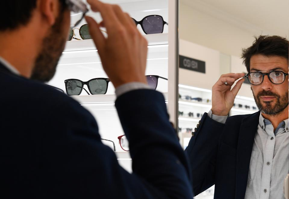 A man tries glasses on July 2, 2018. (Photo: FRED TANNEAU/AFP via Getty Images)