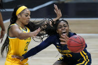 West Virginia's Jayla Hemingway, right, passes the ball under pressure from Baylor's DiJonai Carrington during the first half of an NCAA college basketball game in the final round of the Big 12 Conference tournament in Kansas City, Mo, Sunday, March 14, 2021. (AP Photo/Charlie Riedel)