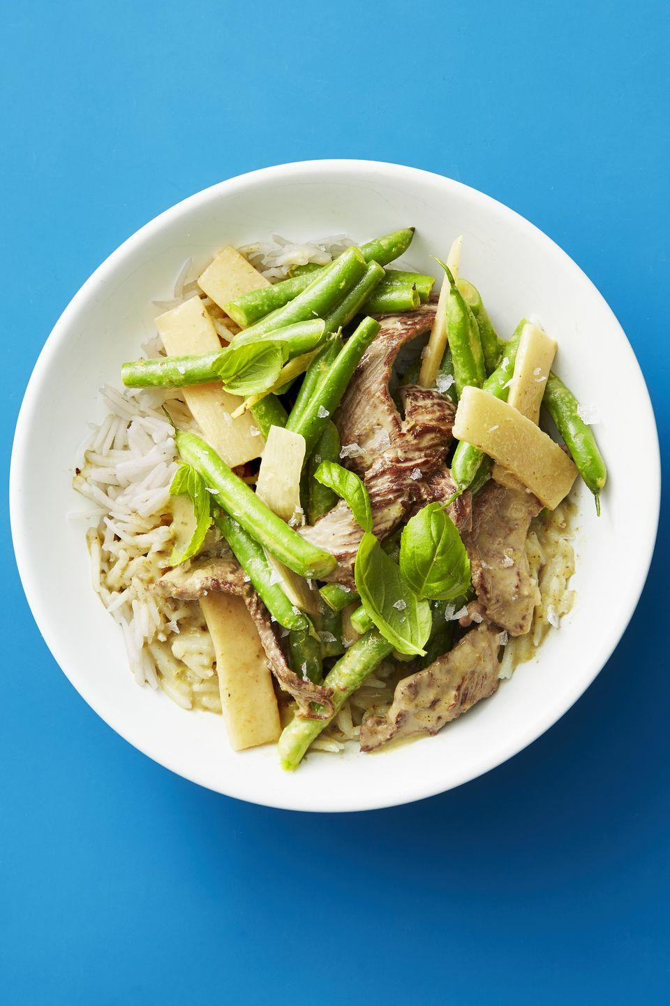 """<p>While a packet of instant rice is both fast and budget friendly, the umami blend of veggies and beef can also be served over noodles, too.</p><p><a href=""""https://www.goodhousekeeping.com/food-recipes/easy/a47888/thai-beef-and-veggie-stir-fry-recipe/"""" rel=""""nofollow noopener"""" target=""""_blank"""" data-ylk=""""slk:Get the recipe for Thai Beef and Veggie Stir-Fry »"""" class=""""link rapid-noclick-resp""""><em>Get the recipe for Thai Beef and Veggie Stir-Fry »</em></a></p>"""