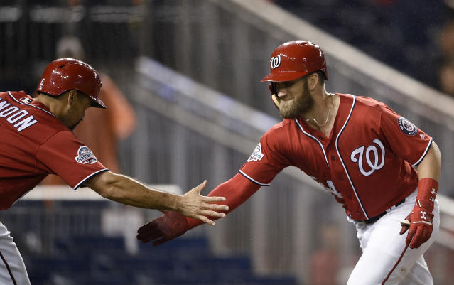 Washington Nationals' Bryce Harper, right, celebrates his two-run home run with Anthony Rendon during the seventh inning of the second baseball game of a doubleheader against the Chicago Cubs, Saturday, Sept. 8, 2018, in Washington. (AP Photo/Nick Wass)