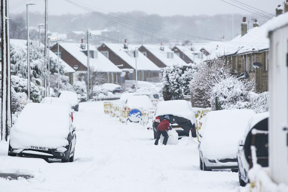 A child rolls a snowball in the West Yorkshire village of Honley. Heavy snow fell overnight in West Yorkshire, causing dangerous driving conditions. (Photo by Adam Vaughan / SOPA Images/Sipa USA)