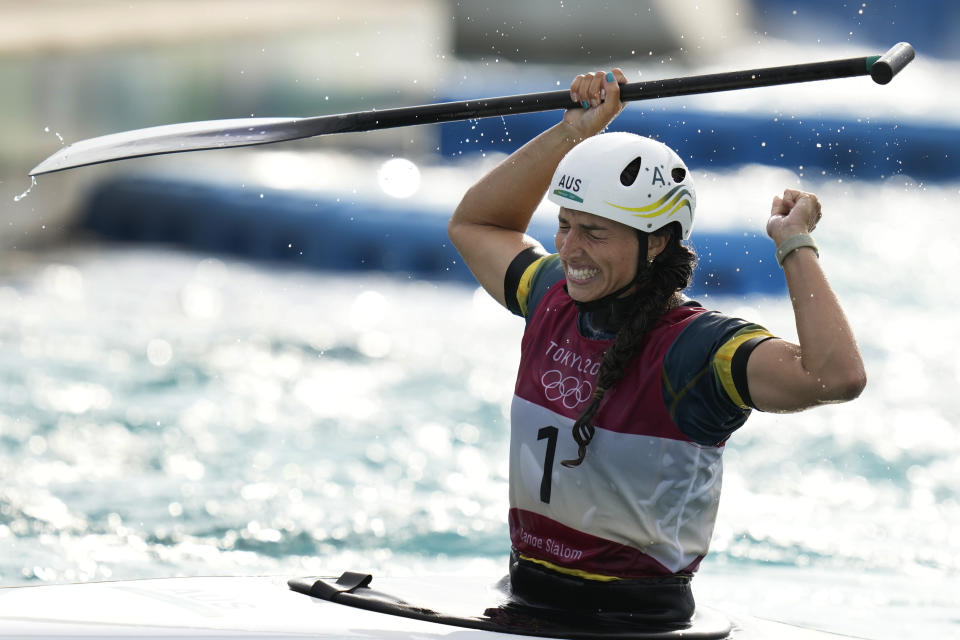 Jessica Fox of Australia celebrates as she crosses the finish line to win gold in the Women's C1 of the Canoe Slalom at the 2020 Summer Olympics, Thursday, July 29, 2021, in Tokyo, Japan. (AP Photo/Kirsty Wigglesworth)