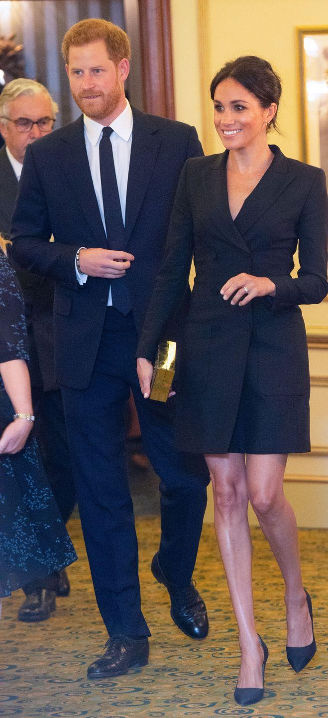 """<p>For her date night with Prince Harry at a charity performance of Hamilton, Meghan Markle wore a stunning black tuxedo dress from Canadian brand <a href=""""https://www.judithandcharles.com/products/digital-dress?variant=13724510552106"""" rel=""""nofollow noopener"""" target=""""_blank"""" data-ylk=""""slk:Judith & Charles"""" class=""""link rapid-noclick-resp"""">Judith & Charles</a>. </p><p>The Duchess teamed the look with a pair of Paul Andrew's 'Pump-it-up' heels in black grosgrain with linen canvas (similar available <a class=""""link rapid-noclick-resp"""" href=""""https://www.farfetch.com/uk/shopping/women/paul-andrew-sling-back-stiletto-pumps-item-12186543.aspx?storeid=9689"""" rel=""""nofollow noopener"""" target=""""_blank"""" data-ylk=""""slk:here"""">here</a>), 'Talon Earrings' by <a class=""""link rapid-noclick-resp"""" href=""""http://www.selfridges.com/GB/en/cat/shaun-leane-sterling-silver-and-gold-vermeil-talon-earrings_970-10179-SLS265/"""" rel=""""nofollow noopener"""" target=""""_blank"""" data-ylk=""""slk:Shaun Leane"""">Shaun Leane</a> and a box clutch bag by Stella McCartney, September 2018.</p>"""