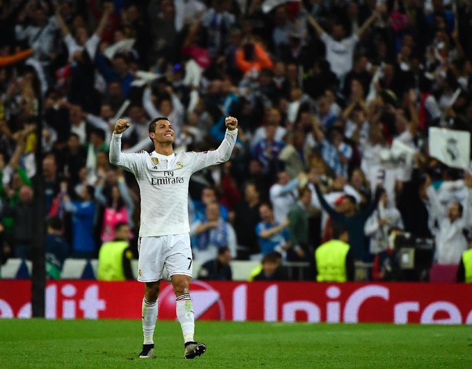 Cristiano Ronaldo celebrates Real Madrid's victory at the end of the Champions League quarter-finals second leg match against Atletico Madrid at the Santiago Bernabeu stadium on April 22, 2015 (AFP Photo/Pierre-Philippe Marcou)